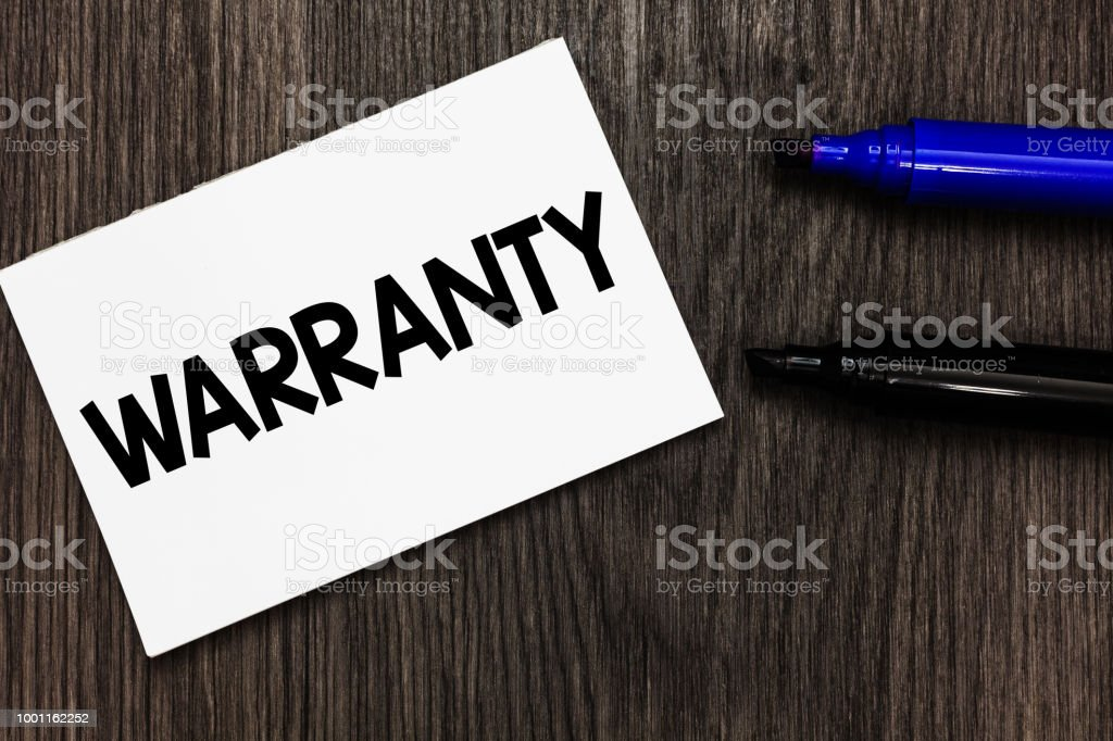 Text sign showing Warranty. Conceptual photo Free service of repair and maintenance of the product sold Important idea ideas notebook marker markers wooden background reminder. stock photo