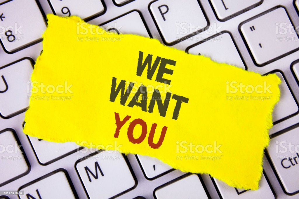 Text sign showing We Want You. Conceptual photo Employee Help Wanted Workers Recruitment Headhunting Employment written on Tear Sticky note paper placed on White Keyboard. Top View. stock photo