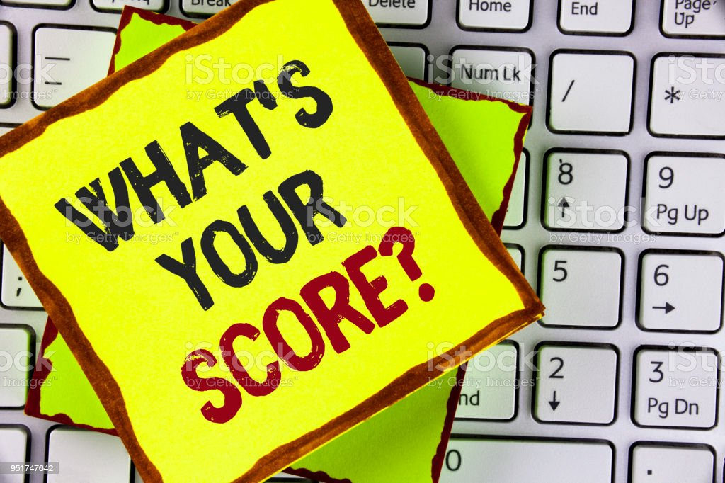 Text sign showing What Is Your Score Question. Conceptual photo Tell Personal Individual Rating Average Results written on Sticky Note Paper placed on the Laptop. stock photo