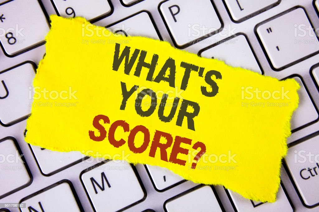 Text sign showing What Is Your Score Question. Conceptual photo Tell Personal Individual Rating Average Results written on Tear Sticky note paper placed on White Keyboard. Top View. stock photo