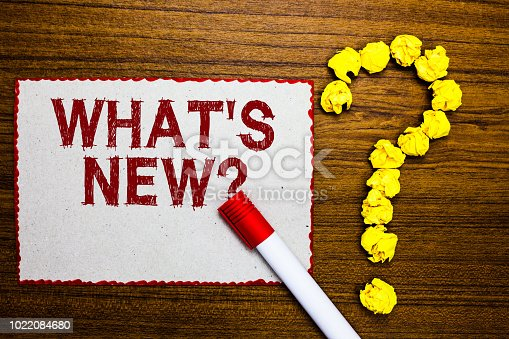 istock Text sign showing What s is New question. Conceptual photo Asking about latest Updates Trends Happening News White paper marker crumpled papers forming question mark wooden background. 1022084680