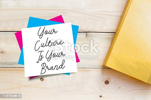 istock text sign showing Your Culture Is Your Brand on white sticky note 1137529516