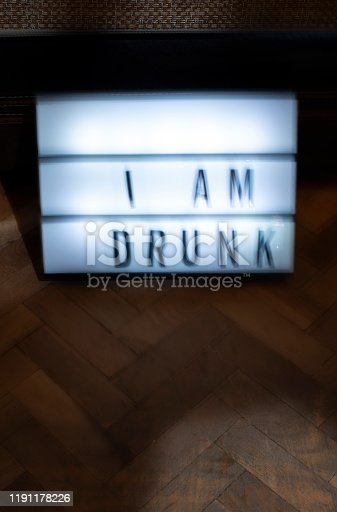 istock Text - Sorry I am drunk on white illuminated board. Concept for alcohol and drinking. 1191178226
