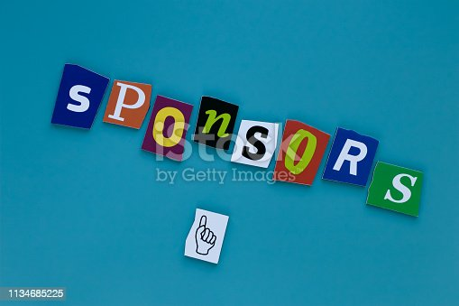 istock Text - sponsors formed from magazine letters on blue background. Word - sponsors formed magazine letters for report design. Donation concept 1134685225
