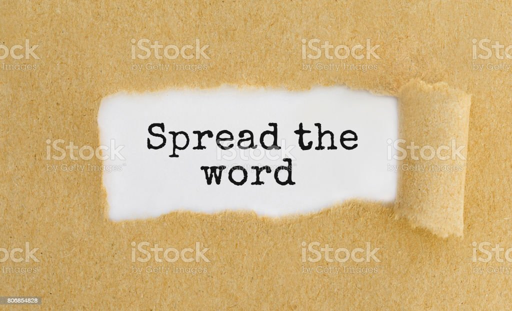Text Spread the word appearing behind ripped brown paper stock photo
