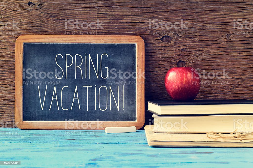 text spring vacation in an old chalkboard stock photo