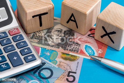 istock text tax with Australian dollar, pen and calculator 942154958