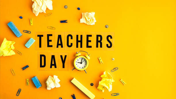 Text TEACHERS DAY on yellow background with school supplies and alarm clock. Back to school stock photo