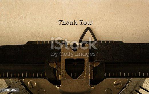 513601840 istock photo Text Thank You typed on retro typewriter 859494676