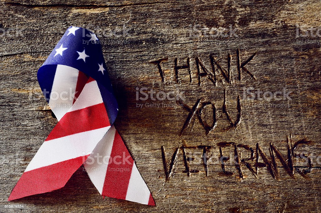text thank you veterans and the flag of the US stock photo