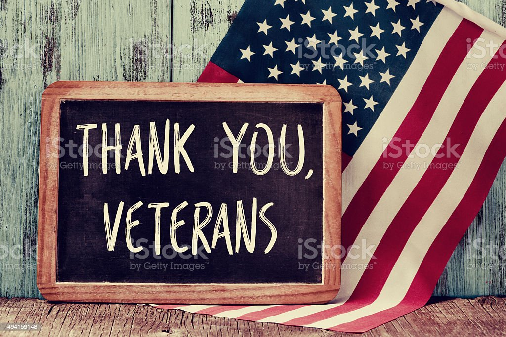 text thank you veterans in a chalkboard of the US stock photo