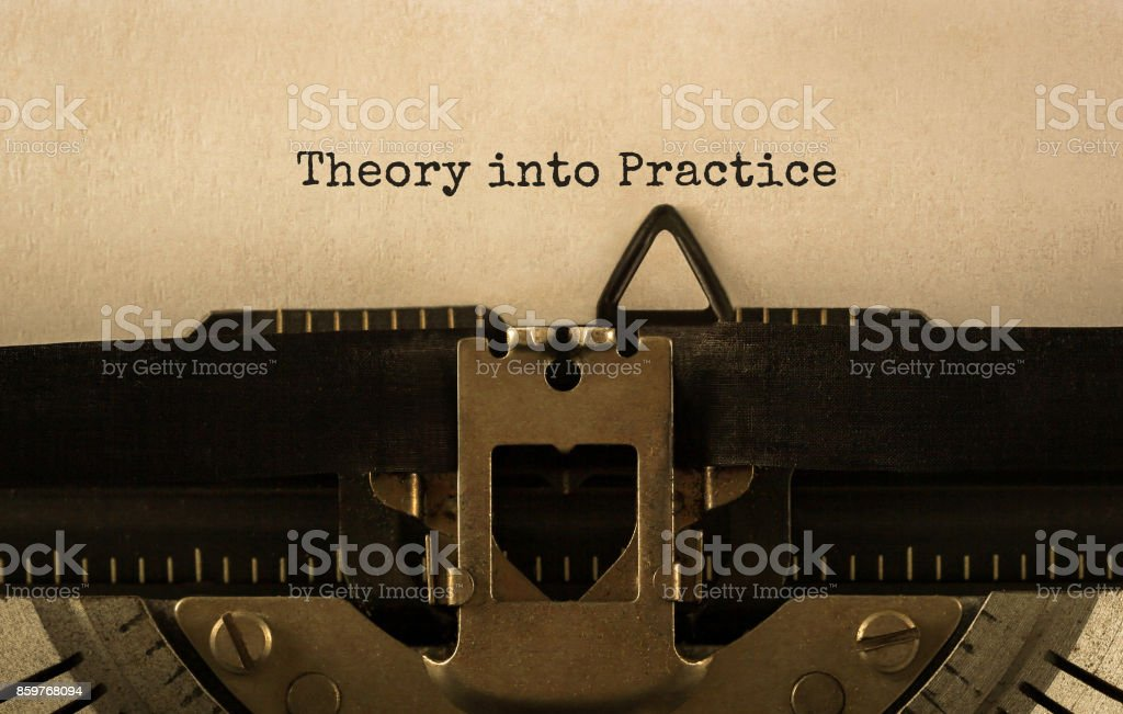 Text Theory into Practice typed on retro typewriter stock photo