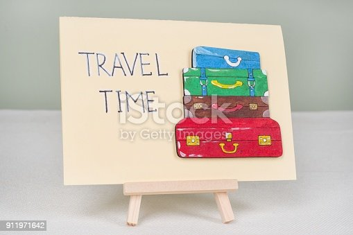 istock Text travel time, postcard with text and a bunch of vintage colored suitcases 911971642