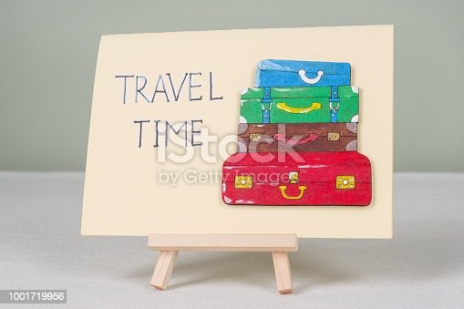 istock Text travel time, postcard with text and bunch of vintage colored suitcases 1001719956