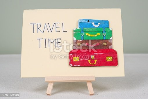 istock Text travel time, postcard with text and bunch of vintage colored suitcases. 979163248