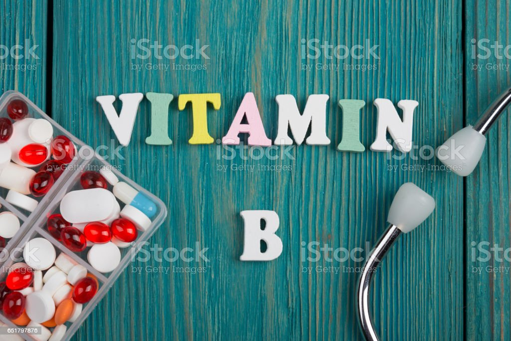 Text 'Vitamin B' of colored wooden letters, stethoscope and pills stock photo