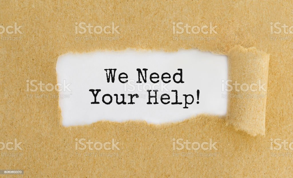 Text We Need Your Help appearing behind ripped brown paper stock photo