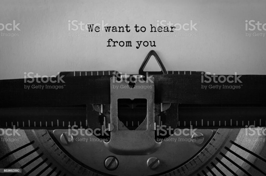 Text We want to hear from you typed on retro typewriter stock photo