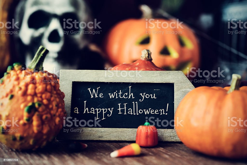 text We witch you a happy Halloween in a chalkboard - foto de stock