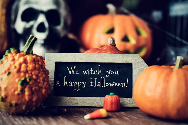 text we witch you a happy halloween in a chalkboard - ハロウィーン ストックフォトと画像