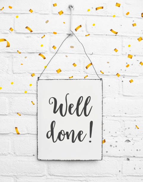 Text well done congratulations on white metal plate with confetti stock photo