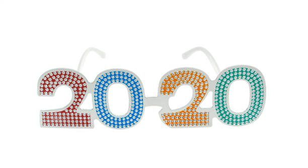 2020 text with eye glasses for New Year Eve celebration on white background stock photo