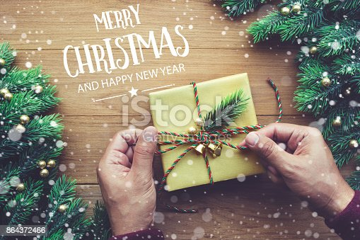 istock MERRY CHRISTMAS AND HAPPY NEW YEAR ,text with gift box 864372466