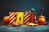 FALL text with pumpkins and fall leaves