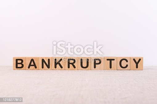 612372074 istock photo Text, word Bankruptcy written on wooden building blocks, on a light background. Business concept 1215277812