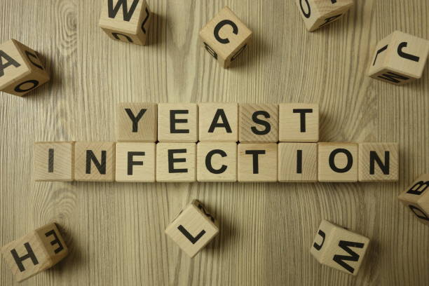 Text yeast infection from wooden blocks stock photo