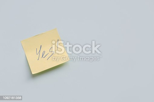istock text Yes on yellow paper sticker on the blue background, Success, Goal Concept 1092181358