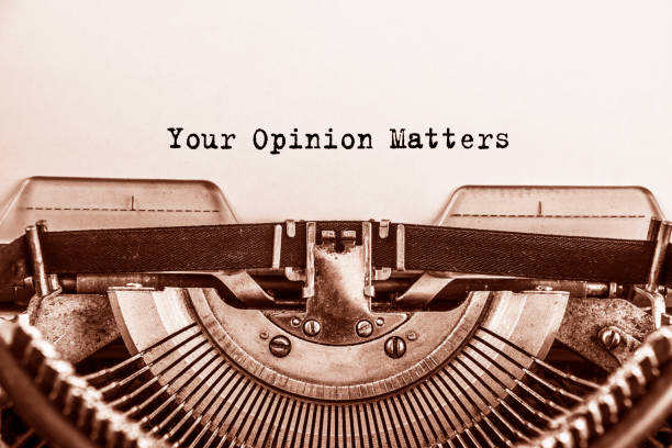 Text Your Opinion Matters typed on vintage typewriter retro stock photo