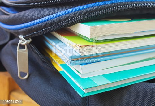 Textbooks in the school backpack, education concept.  Selective focus.