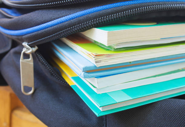 Textbooks in the school backpack, education concept.  Selective focus. Textbooks in the school backpack, education concept.  Selective focus. textbook stock pictures, royalty-free photos & images