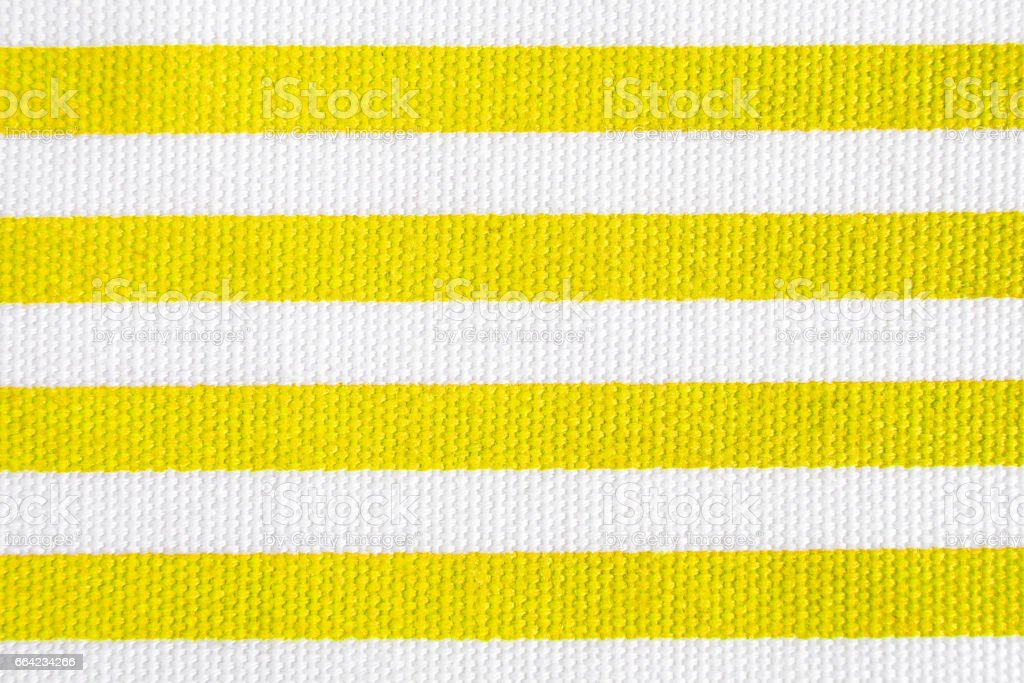 Textile background with yellow and white stripes. Fabric texture stock photo