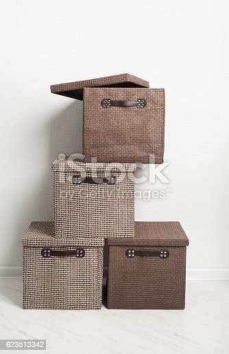 istock Textile beige and brown storage boxes 623513342
