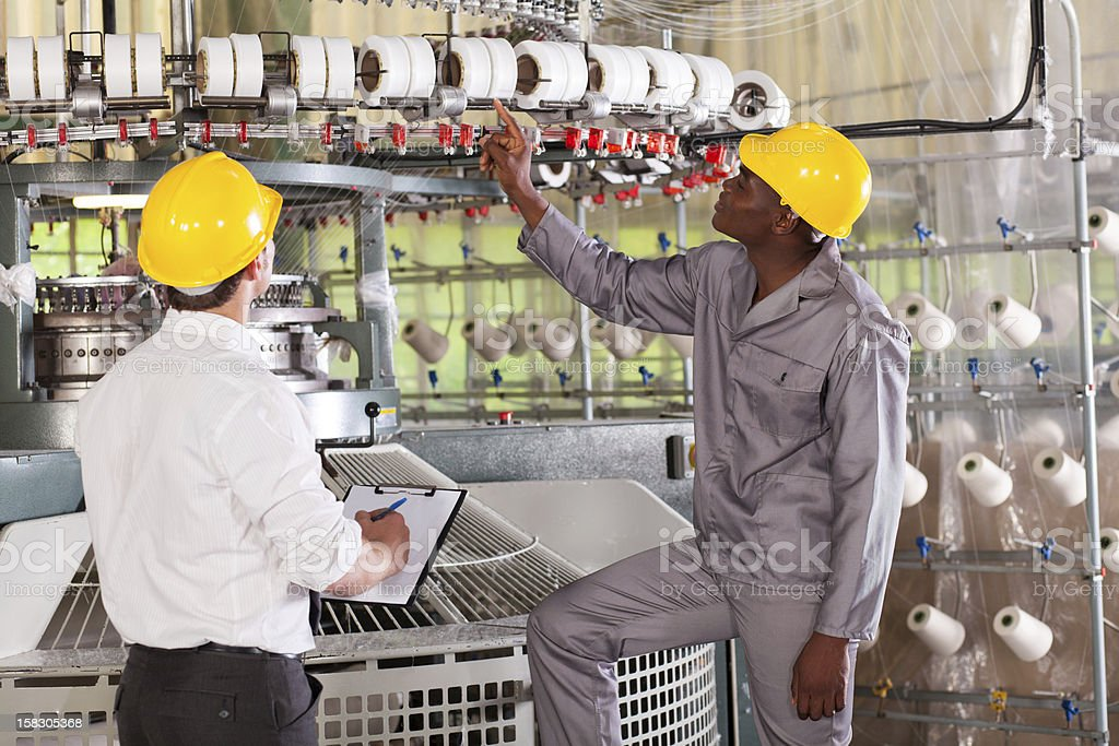 textile factory manager and worker stock photo