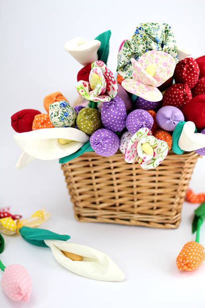 Textile flowers in a basket stock photo