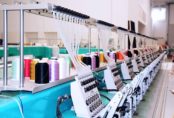 textile: industrial embroidery machine - embroidery machine stock pictures, royalty-free photos & images