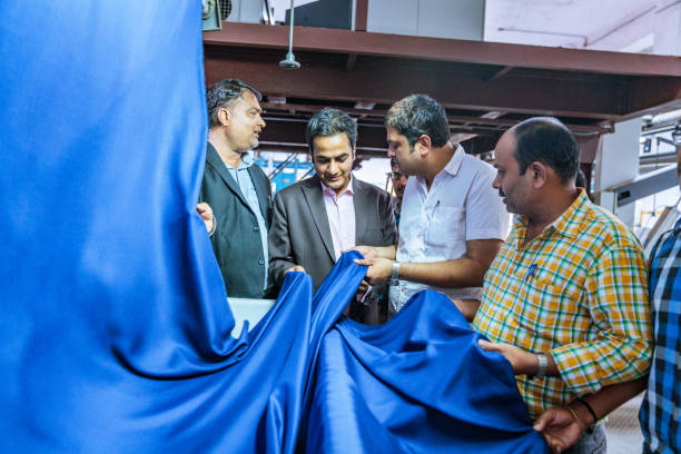 Textile Industry Owner Inspecting the Quality stock photo