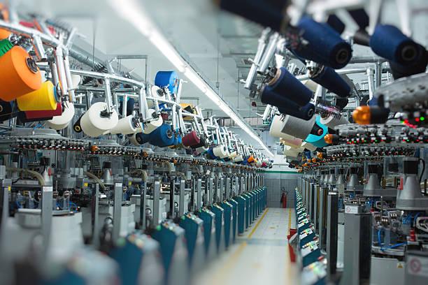 przemysł włókienniczy-kostkę - przemysł włókienniczy zdjęcia i obrazy z banku zdjęć
