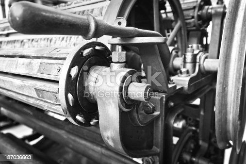 Black and white image of textile machine detail in manufacturing plant.