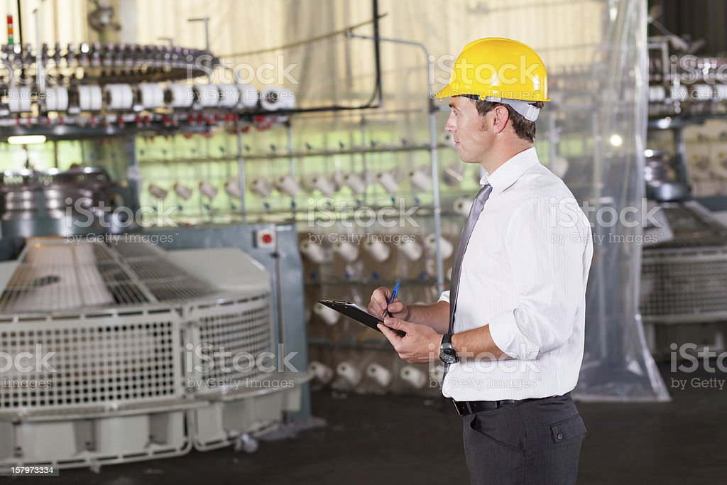 textile production manager stock photo