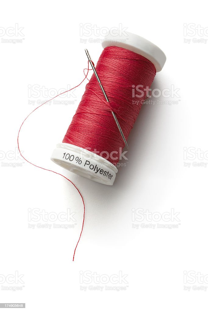 Textile: Red Thread and Needle stock photo