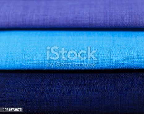 Textile samples. Textile samples for curtains. Blue tone curtain samples hanging. Choice of fabric for home interior.