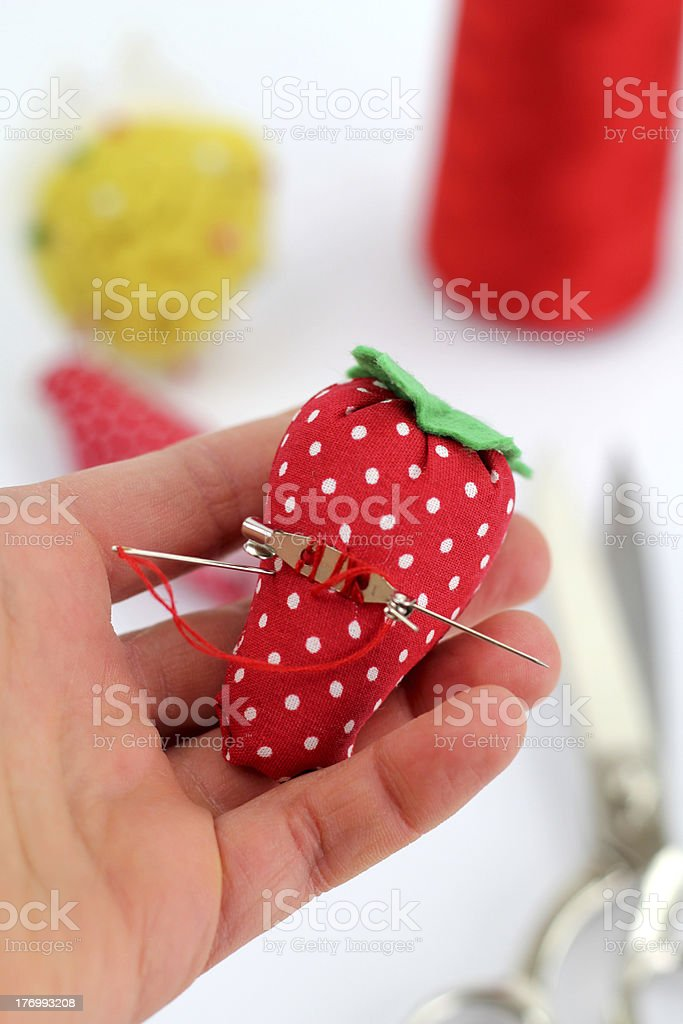 Textile strawberry brooch stock photo