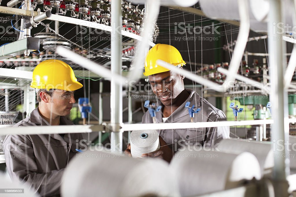 textile workers at work stock photo