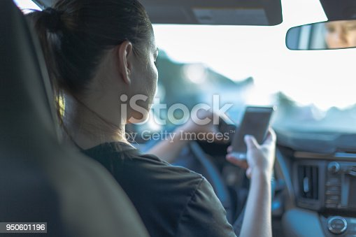 istock Texting and driving, behind the wheel. Breaking the law. 950601196