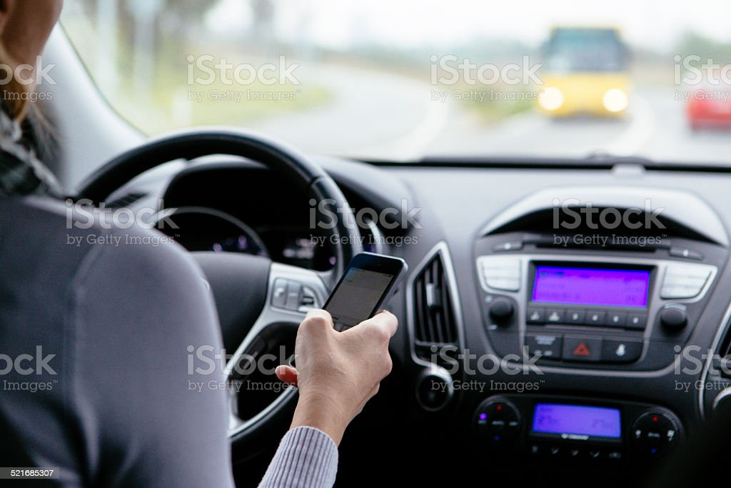 Texting and driving. stock photo