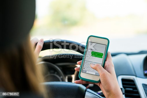 istock Texting and Driving 664786352